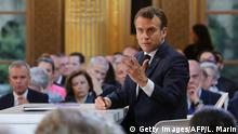 French President Emmanuel Macron gestures during his live address following the Great National Debate, at the Elysee Palace in Paris on April 25, 2019. - President Emmanuel Macron on April 25, 2019 vowed to press ahead with his government's programme to transform France, adding public order must be restored after months of protests. (Photo by ludovic MARIN / AFP) (Photo credit should read LUDOVIC MARIN/AFP/Getty Images)