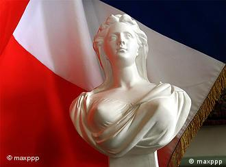 French flag behind a sculpture