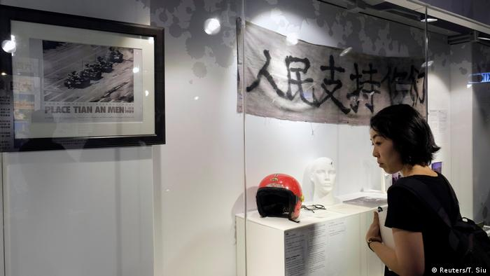 A woman looks at exhibits in the June 4th Museum
