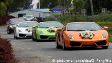Lamborghini sports cars are pictured in a luxury wedding motorcade in Wenzhou city, east Chinas Zhejiang province, 21 April 2011. The luxury motorcade consists of 4 Lamborghini and 4 Ferrari sports cars, 8 Rolls-Royce and 10 Bentley limousines. The total price of these cars are estimated to exceed 100 million yuan (US$15.4 million). A growing number of rich people in China, especially entrepreneurs or their children, hold extravagant weddings to show off their wealth which they gained from the countrys booming economy. Photo: Zheng Peng Wz/Imaginechina |