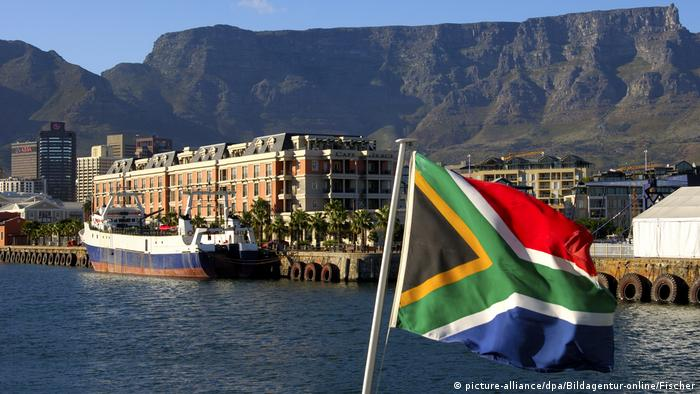 The South African flag with Table Mountain in the background