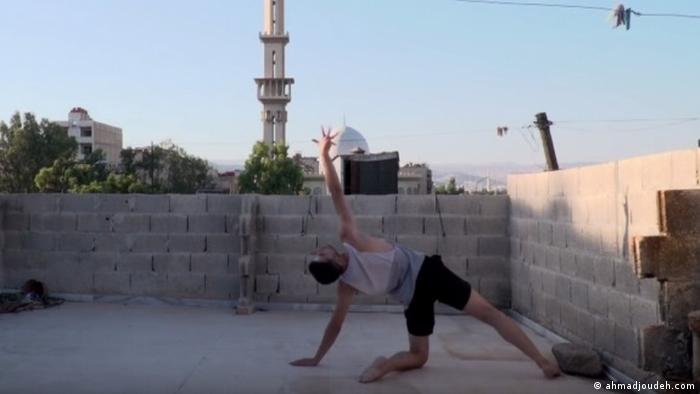 Dancer Ahmad Joudeh on a Damascus rooftop