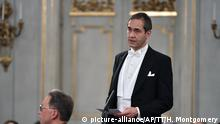 Newly appointed academy member Mats Malm delivers his installation speech during the Swedish Academy's formal gathering at the Old Stock Exchange building in Stockholm, Thursday, Dec. 20, 2018. (Henrik Montgomery/TT News Agency via AP) |