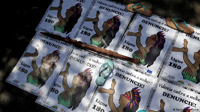 Signs are seen during a protest by indigenous people to defend indigenous land and cultural rights that they say are threatened by the right-wing government of Brazil's President Jair Bolsonaro