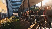 People wait in line for the Foreigners Office in Berlin