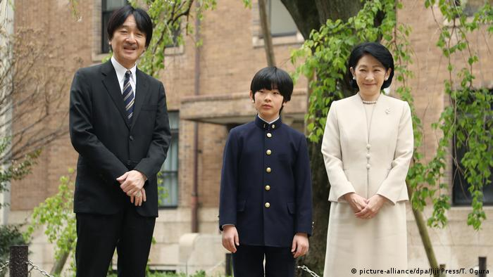 Prince Hisahito standing between his parents