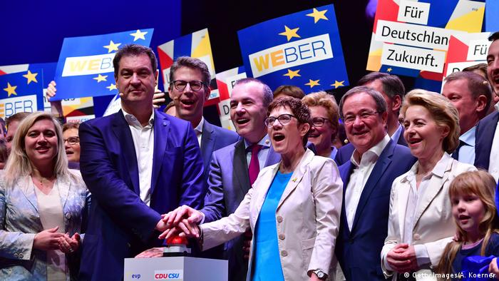 An image from the CDU/CSU campaign for the European elections in May. Von der Leyen is on the right of the image, which also includes former lead candidate Manfred Weber. (Getty Images/A. Koerner)
