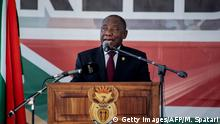 South Africa President Cyril Ramaphosa (C) addresses the crowd at the Miki Yili Stadium, Makhanda, Eastern Cape Province, ahead of the celebrations for the 25th anniversary of Freedom Day on April 27, 2019. - Freedom Day commemorates the first democratic post-apartheid elections held in South Africa on April 27, 1994. (Photo by Michele Spatari / AFP) (Photo credit should read MICHELE SPATARI/AFP/Getty Images)