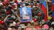 Supporters of Venezuelan President Nicolas Maduro join a government rally against the Organization of American States, in Caracas, Venezuela, Saturday, April 27, 2019. The Trump administration has added Venezuelan Foreign Minister Jorge Arreaza to a Treasury Department sanctions target list as it increases pressure on embattled President Nicolas Maduro. (AP Photo/Ariana Cubillos) |