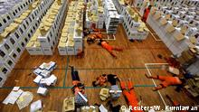 Workers lay during a break as they prepare election materials before their distribution to polling stations in a warehouse in Jakarta, Indonesia, April 15, 2019. REUTERS/Willy Kurniawan TPX IMAGES OF THE DAY