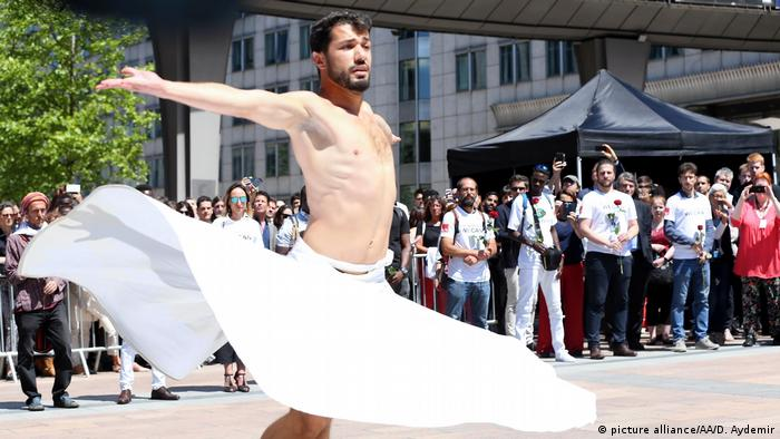 Joudeh dancing in front of the EU Parliament in Brussels as part of the 2018 World Refugee Day events