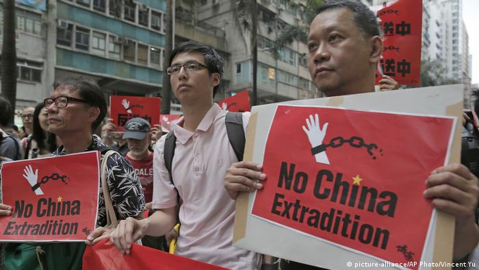 Protesters holding placards that read No China Extradition