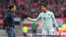 28.04.2019 +++ Bayern Munich's Croatian headcoach Niko Kovac (L) speaks with Bayern Munich's Spanish midfielder Thiago Alcantara during the German first division Bundesliga football match Nuremberg v FC Bayern Munich on April 28, 2019 in Nuremberg, southern Germany. (Photo by Christof STACHE / AFP) / RESTRICTIONS: DFL REGULATIONS PROHIBIT ANY USE OF PHOTOGRAPHS AS IMAGE SEQUENCES AND/OR QUASI-VIDEO (Photo credit should read CHRISTOF STACHE/AFP/Getty Images)