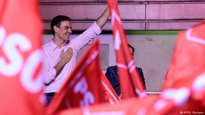 Sanchez surrounded by PSOE flags in Madrid