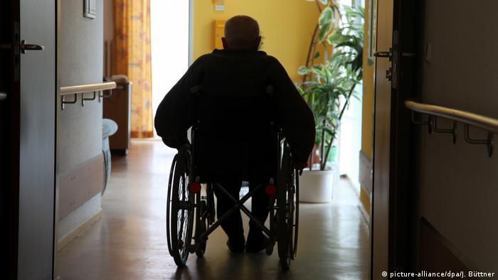 Silhouette of a man in a wheelchair