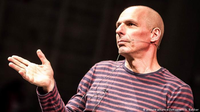 Yanis Varoufakis, man with a microphone gestures