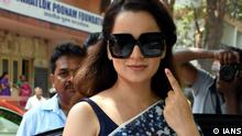 Mumbai: Actress Kangana Ranaut shows her forefinger marked with indelible ink after casting vote during the fourth phase of 2019 Lok Sabha elections in Mumbai on April 29, 2019. (Photo: IANS)