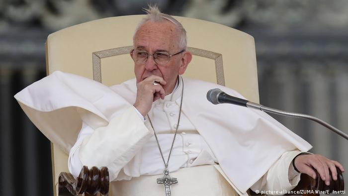 Pope Francis' hair waves in the wind