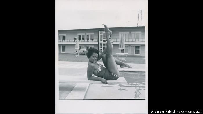 Afro-American model in bathing suit, lying on a diving board (Johnson Publishing Company, LLC.)