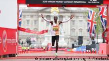 28.04.2019 28th April 2019, London, England; The 2019 Virgin London Marathon; Eliud Kipchoge of Kenya finishes in 1st place in the Men's Elite  