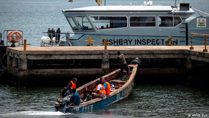 Fishery boat is tied up to a wharf (AFP/S. Bah)