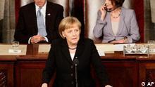 German Chancellor Angela Merkel addresses a joint session of Congress, Tuesday, Nov. 3, 2009, on Capitol Hill in Washington. Vice President Joe Biden, left, and House Speaker Nancy Pelosi of Calif. listen. (AP Photo/J. David Ake)
