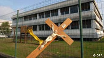 A cross in front of a school
