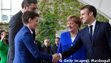 German Chancellor Angela Merkel (2nd R) and French President Emmanuel Macron (R) greet Serbian President Aleksandar Vucic and Serbia's Prime Minister Ana Brnabic as they arive at the chancellery in Berlin on April 29, 2019 for the West Balkans conference. - German Chancellor Angela Merkel and French President Emmanuel Macron are hosting the Western Balkans leaders and EU members Croatia and Slovenia hoping to reboot a dialogue between bitter foes Serbia and Kosovo over one of the Balkans' thorniest disputes. (Photo by John MACDOUGALL / AFP) (Photo credit should read JOHN MACDOUGALL/AFP/Getty Images)