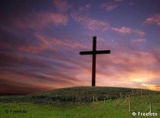 A cross standing on a field