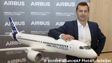 Airbus President Commercial Aricraft and future CEO of the Airbus group Guillaume Faury poses with a replica of an A220 aircraft after the presentation of Airbus 2018 results in Toulouse, southern France, Thursday, Feb.14, 2019. European plane manufacturer Airbus said Thursday it will stop making its superjumbo A380 in 2021 for lack of customers, abandoning the world's biggest passenger jet and one of the aviation industry's most ambitious and most troubled endeavors. (AP Photo/Fred Scheiber) |