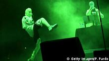 Russian political activist Nadya Tolokonnikova (L) of feminist protest punk rock group Pussy Riot performs during the Mexican musicial festival Vive Latino, at the Foro Sol in Mexico City, on March 18, 2018. / AFP PHOTO / PEDRO PARDO (Photo credit should read PEDRO PARDO/AFP/Getty Images)