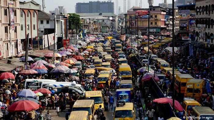 Street teeming with people and vehicles in Nigeria's commercial capital, Lagos