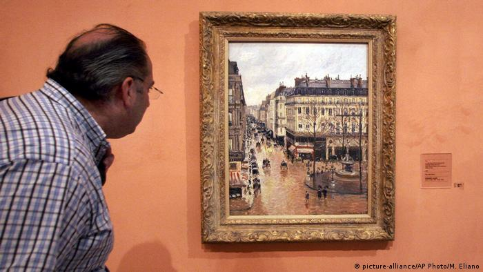 Camille Pissarro Rue Saint-Honoré in the Afternoon. Effect of Rain