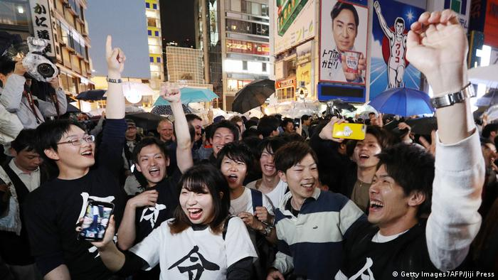 Residents of Osaka celebrate Naruhito's accession to the throne (Getty Images7AFP/Jiji Press)