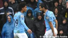CARDIFF, WALES - SEPTEMBER 22: Ilkay Gundogan of Manchester City celebrates with teammate Leroy Sane after scoring his team's third goal during the Premier League match between Cardiff City and Manchester City at Cardiff City Stadium on September 22, 2018 in Cardiff, United Kingdom. (Photo by Stu Forster/Getty Images)