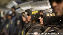 """FILE- A Dec. 29, 2018 file photo of Bangladesh police's elite Rapid Action Battalion (RAB), a security force focused on combating extremist groups, in Dhaka, Bangladesh. Indian and Bangladeshi officials and security experts largely dismissed a fresh threat of violence from an Islamic State-aligned media group, insisting that routine monitoring of would-be militants would prevent a Sri Lanka-style attack from taking place elsewhere in South Asia. Al-Mursalat Media released a graphic on Tuesday of five militants who carried out a 2016 attack at a cafe in the diplomatic enclave of Bangladesh's capital, Dhaka, according to global terrorism monitor SITE Intelligence. Mufti Mahmud Khan, a spokesman for RAB, told The Associated Press that he didn't place """"any great emphasis"""" on the threat released by the IS-aligned media group. (AP Photo/Anupam Nath, File) 