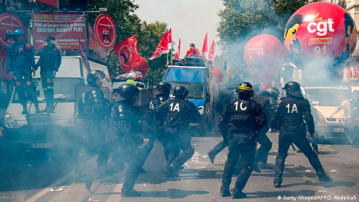Police fire tear gas ahead of the May Day rally in Paris
