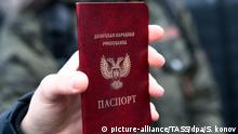 ST PETERSBURG, RUSSIA - FEBRUARY 18, 2017: A participant in a rally in solidarity with Donbass people shows a passport of the Donetsk People's Republic. On February 18, 2017, Russian President Vladimir Putin signed a decree to recognise identity documents and vehicle registration plates issued to Ukrainian citizens and stateless persons permanently residing n certain districts of Ukraine's Donetsk and Lugansk Regions. Sergei Konkov/TASS |