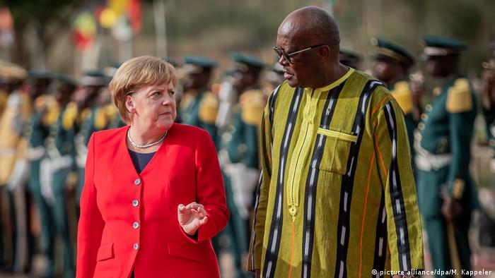 German Chancellor Angela Merkel with Burkina Faso's president, Roch Marc Christian Kabore, in Ouagadougou, Burkina Faso, earlier this month (picture alliance/dpa/M. Kappeler)