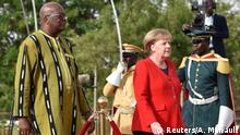 01.05.2019 *** German Chancellor Angela Merkel is greeted by Burkina Faso President Roch Marc Christian Kabore in Ouagadougou, Burkina Faso May 1, 2019 prior to attending a meeting of West African leaders of the G5 Sahel. REUTERS/Anne Mimault
