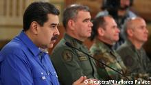 30.04.2019 *** Venezuela's President Nicolas Maduro speaks during a broadcast with members of the government and military high command members at Miraflores Palace in Caracas, Venezuela April 30, 2019. Miraflores Palace/Handout via REUTERS ATTENTION EDITORS - THIS PICTURE WAS PROVIDED BY A THIRD PARTY.