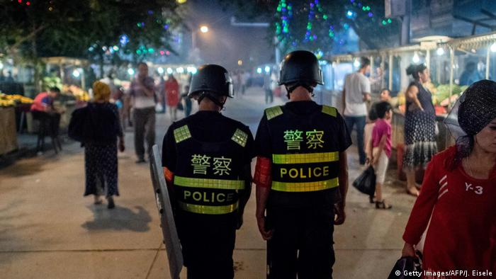 Chinese police patrol near the Id Kah Mosque in the Xinjiang autonomous region