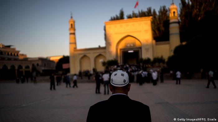 A Uighur man outside a mosque in Xinjiang province, China