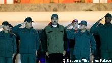 Venezuela's President Nicolas Maduro stands next to Venezuela's Defense Minister Vladimir Padrino Lopez and Remigio Ceballos, Strategic Operational Commander of the Bolivarian National Armed Forces, during a ceremony at a military base in Caracas, Venezuela May 2, 2019. Miraflores Palace/Handout via REUTERS ATTENTION EDITORS - THIS PICTURE WAS PROVIDED BY A THIRD PARTY.