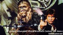 This photo provided by Twentieth Century Fox Home Entertainment shows, Peter Mayhew as Chewbacca, left, and Harrison Ford as Hans Solo in the original 1977 Star Wars: Episode IV - A New Hope film, included in the new Blu-ray release of Star Wars: The Complete Saga out on Oct. 13, 2015. The new film, Star Wars: The Force Awakens, opens in U.S. theaters on Dec. 18, 2015. (Twentieth Century Fox Home Entertainment via AP) |