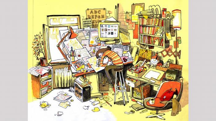 Zeichnung von Mawil zeigt einen Zeichner, der über einen Scheibtisch voll von Notizen und Zettel gebeugt ist (Copyright: Mawil).