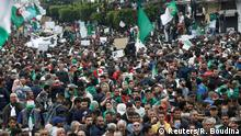 Demonstrators hold flags and banners demanding the departure of Algeria's ruling elite, a month after the downfall of President Abdelaziz Bouteflik, during an anti-government protest in Algiers, Algeria, May 3, 2019. REUTERS/Ramzi Boudina