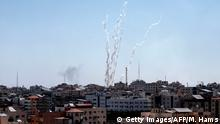 04.05.2019 A picture taken from the Gaza Strip on May 4, 2019 shows missiles being launched toward Israel. - A barrage of around 50 rockets was fired at Israel from the Gaza Strip on Saturday and dozens were intercepted by air defences, the Israeli army said. (Photo by MAHMUD HAMS / AFP) (Photo credit should read MAHMUD HAMS/AFP/Getty Images)