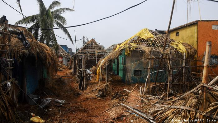 Houses without roofs and debris in the aftermath of a cyclone