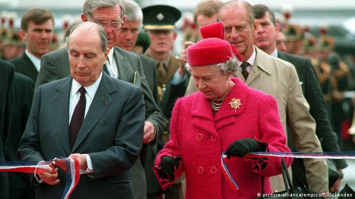 Queen Elizabeth II and then-French President Francois Mitterrand cut the ribbon at the opening ceremony for the Channel Tunnel